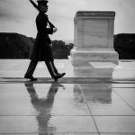 Lone soldier with rifle marching in front of the tomb of the unknown soldier in Washington DC