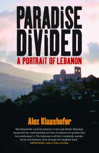 Lebanese mountaintop village against a dusk skyline which is the cover of Paradise Divided by Alex Klaushofer