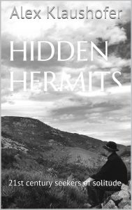 Photo of Hidden Hermits book - man sat looking at a large hill