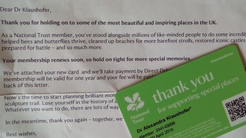 Green National Trust card on a letter about membership renewal