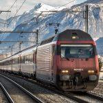 Swiss train against mountains